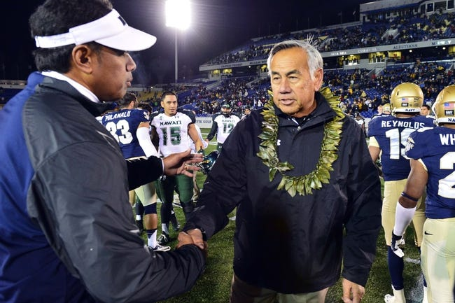 Nov 9, 2013; Annapolis, MD, USA; Hawaii Warriors head coach Norm Chow (right) meets Navy Midshipmen head coach Ken Niumatalolo at the middle of the field after the game at Navy Marine Corps Memorial Stadium. Navy defeated Hawaii 42-38 Mandatory Credit: Tommy Gilligan-USA TODAY Sports