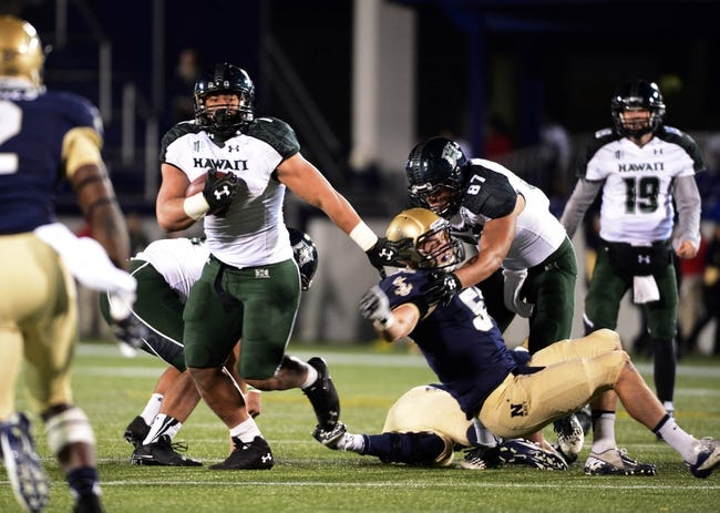 Nov 9, 2013; Annapolis, MD, USA; Hawaii Warriors running back Joey Iosefa (7) runs with the ball during the fourth quarter against the Navy Midshipmen at Navy Marine Corps Memorial Stadium. Navy defeated Hawaii 42-38 Mandatory Credit: Tommy Gilligan-USA TODAY Sports