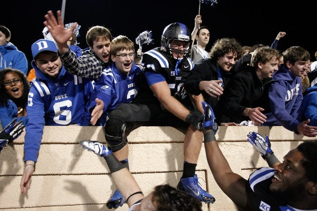Nov 9, 2013; Durham, NC, USA; Duke Blue Devils linebacker Kelby Brown (59) celebrates with fans after beating the North Carolina State Wolfpack 38-20 at Wallace Wade Stadium. Mandatory Credit: Mark Dolejs-USA TODAY Sports