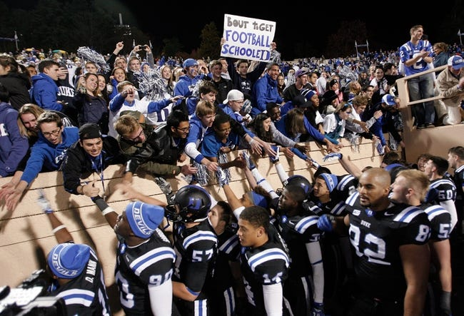 Nov 9, 2013; Durham, NC, USA; Duke Blue Devils fans celebrate with the team after beating the North Carolina State Wolfpack 38-20 at Wallace Wade Stadium. Mandatory Credit: Mark Dolejs-USA TODAY Sports