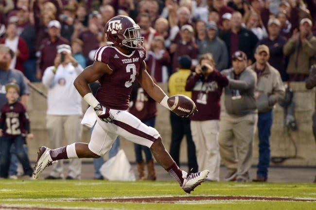 Nov 9, 2013; College Station, TX, USA; Texas A&M Aggies running back Trey Williams (3) scores a touchdown against the Mississippi State Bulldogs during the second half at Kyle Field. Texas A&M won 51-41. Mandatory Credit: Thomas Campbell-USA TODAY Sports