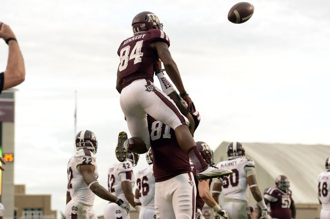 Nov 9, 2013; College Station, TX, USA; Texas A&M Aggies wide receiver Malcome Kennedy (84) celebrates scoring a touchdown with tight end Nehemiah Hicks (81) against the Mississippi State Bulldogs during the second half at Kyle Field. Texas A&M won 51-41. Mandatory Credit: Thomas Campbell-USA TODAY Sports