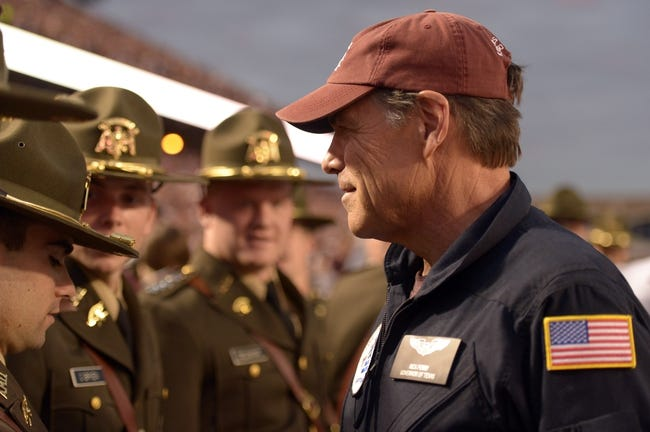 Nov 9, 2013; College Station, TX, USA; Texas Governor Rick Perry greets Texas A&M Aggies Corps of Cadets students against the Mississippi State Bulldogs during the second half at Kyle Field. Texas A&M won 51-41. Mandatory Credit: Thomas Campbell-USA TODAY Sports