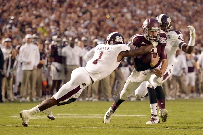 Nov 9, 2013; College Station, TX, USA; Mississippi State Bulldogs defensive back Nickoe Whitley (1) tackles Texas A&M Aggies quarterback Johnny Manziel (2) during the second half at Kyle Field. Texas A&M won 51-41. Mandatory Credit: Thomas Campbell-USA TODAY Sports