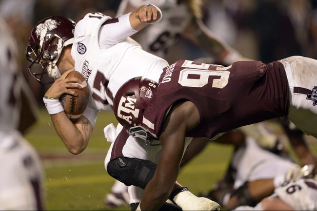 Nov 9, 2013; College Station, TX, USA; Texas A&M Aggies defensive lineman Julien Obioha (95) stops Mississippi State Bulldogs quarterback Tyler Russell (17) from converting a 2-point conversion during the second half at Kyle Field. Texas A&M won 51-41. Mandatory Credit: Thomas Campbell-USA TODAY Sports