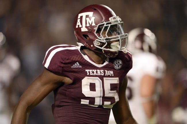 Nov 9, 2013; College Station, TX, USA; Texas A&M Aggies defensive lineman Julien Obioha (95) celebrates stopping a two-point conversion against the Mississippi State Bulldogs during the second half at Kyle Field. Texas A&M won 51-41. Mandatory Credit: Thomas Campbell-USA TODAY Sports