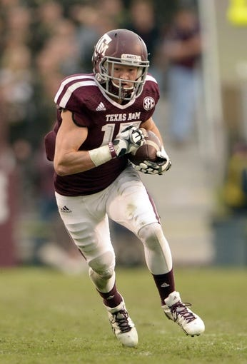 Nov 9, 2013; College Station, TX, USA; Texas A&M Aggies wide receiver Travis Labhart (15) runs after a catch against the Mississippi State Bulldogs during the second half at Kyle Field. Texas A&M won 51-41. Mandatory Credit: Thomas Campbell-USA TODAY Sports