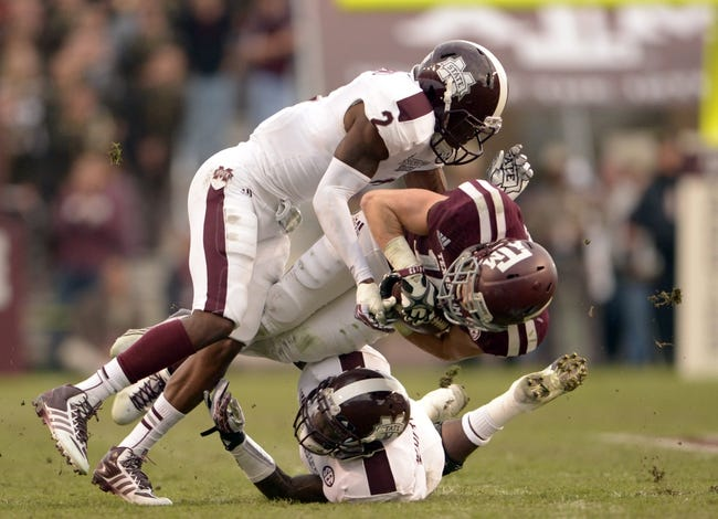 Nov 9, 2013; College Station, TX, USA; Mississippi State Bulldogs defensive back Will Redmond (2) tackles Texas A&M Aggies wide receiver Travis Labhart (15) during the second half at Kyle Field. Texas A&M won 51-41. Mandatory Credit: Thomas Campbell-USA TODAY Sports