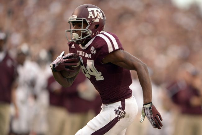 Nov 9, 2013; College Station, TX, USA; Texas A&M Aggies wide receiver Malcome Kennedy (84) runs for a touchdown after a catch against the Mississippi State Bulldogs during the second half at Kyle Field. Texas A&M won 51-41. Mandatory Credit: Thomas Campbell-USA TODAY Sports