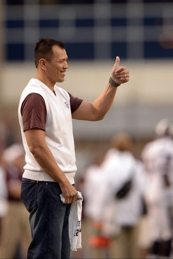 Nov 9, 2013; College Station, TX, USA; Former Texas A&M Aggies linebacker Dat Nguyen waves to fans against the Mississippi State Bulldogs during the second half at Kyle Field. Texas A&M won 51-41. Mandatory Credit: Thomas Campbell-USA TODAY Sports