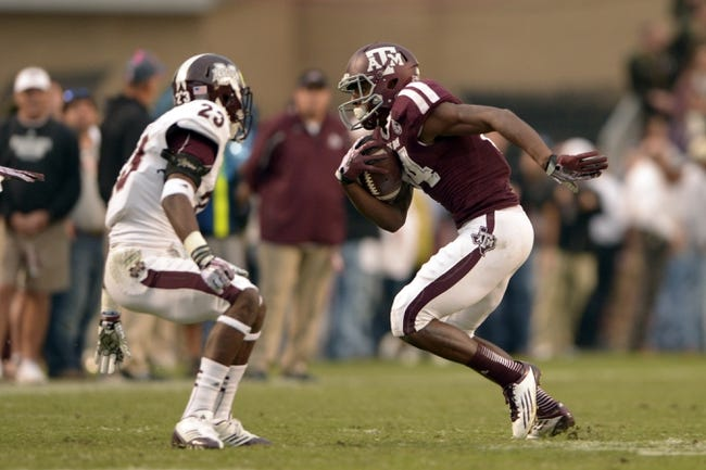 Nov 9, 2013; College Station, TX, USA; Texas A&M Aggies wide receiver Malcome Kennedy (84) runs after a catch against Mississippi State Bulldogs defensive back Taveze Calhoun (23) during the second half at Kyle Field. Texas A&M won 51-41. Mandatory Credit: Thomas Campbell-USA TODAY Sports