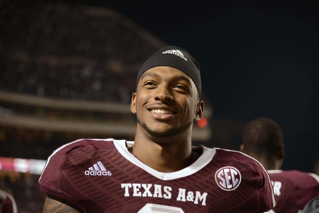 Nov 9, 2013; College Station, TX, USA; Texas A&M Aggies linebacker Nate Askew (9) smiles against the Mississippi State Bulldogs during the second half at Kyle Field. Texas A&M won 51-41. Mandatory Credit: Thomas Campbell-USA TODAY Sports
