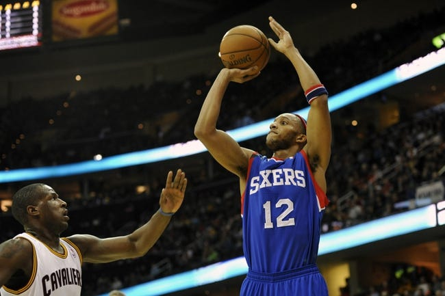 Nov 9, 2013; Cleveland, OH, USA; Philadelphia 76ers small forward Evan Turner (12) shoots over Cleveland Cavaliers shooting guard Dion Waiters (3) in the first quarter at Quicken Loans Arena. Mandatory Credit: David Richard-USA TODAY Sports