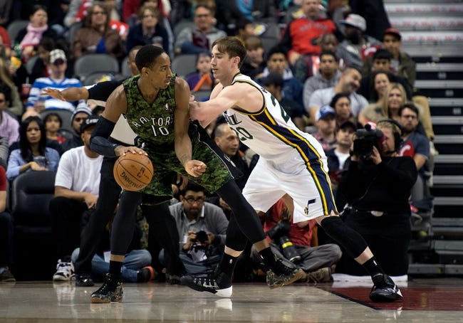 Nov 9, 2013; Toronto, Ontario, CAN; Toronto Raptors shooting guard DeMar DeRozan (10) looks to play the ball as Utah Jazz shooting guard Gordon Hayward (20) tries to defend during the first period in a game at Air Canada Centre. Mandatory Credit: Nick Turchiaro-USA TODAY Sports