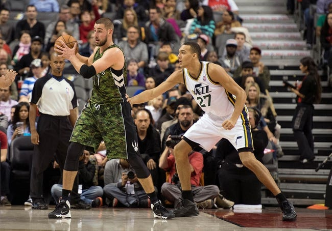 Nov 9, 2013; Toronto, Ontario, CAN; Toronto Raptors center Jonas Valanciunas (17) looks to play the ball as Utah Jazz center Rudy Gobert (27) tries to defend during the first period in a game at Air Canada Centre. Mandatory Credit: Nick Turchiaro-USA TODAY Sports