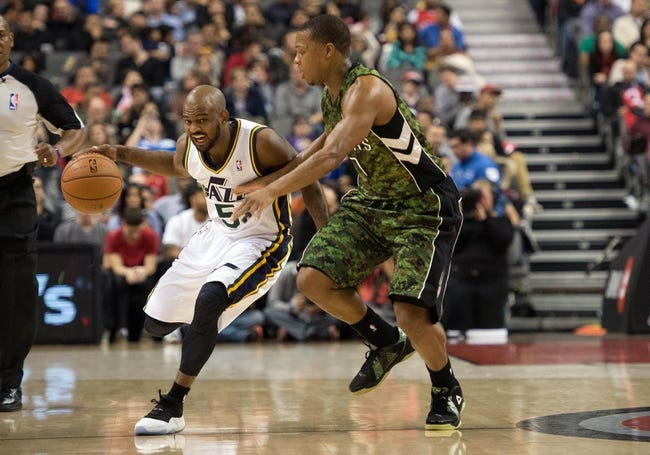 Nov 9, 2013; Toronto, Ontario, CAN; Utah Jazz point guard John Lucas III (5) takes the ball up court as Toronto Raptors point guard Kyle Lowry (7) tries to defend during the first period in a game at Air Canada Centre. Mandatory Credit: Nick Turchiaro-USA TODAY Sports