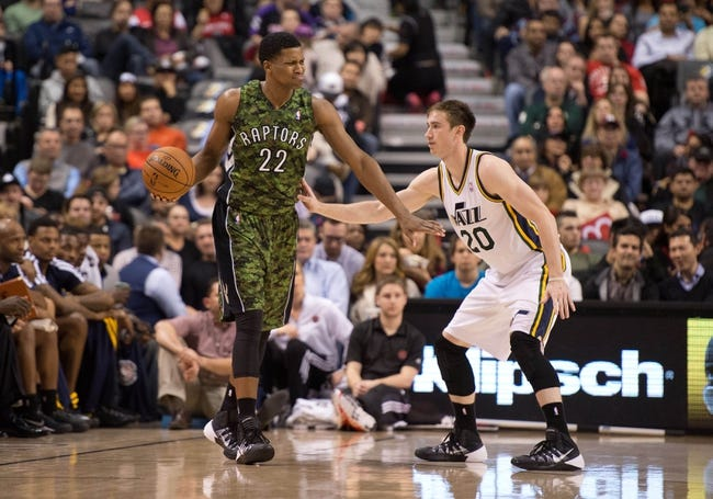 Nov 9, 2013; Toronto, Ontario, CAN; Toronto Raptors small forward Rudy Gay (22) looks to play the ball as Utah Jazz shooting guard Gordon Hayward (20) tries to defend during the second period in a game at Air Canada Centre. Mandatory Credit: Nick Turchiaro-USA TODAY Sports