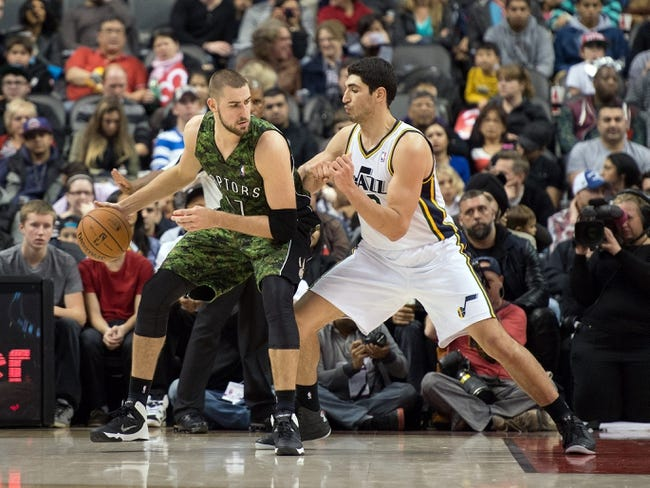 Nov 9, 2013; Toronto, Ontario, CAN; Toronto Raptors center Jonas Valanciunas (17) looks to play the ball as Utah Jazz center Enes Kanter (0) tries to defend during the second period in a game at Air Canada Centre. Mandatory Credit: Nick Turchiaro-USA TODAY Sports