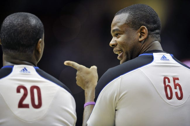 Nov 9, 2013; Cleveland, OH, USA; NBA referee referee Sean Wright (65) talks to referee Leroy Richardson (20) in the second quarter of a game between the Cleveland Cavaliers and the Philadelphia 76ers at Quicken Loans Arena. Mandatory Credit: David Richard-USA TODAY Sports