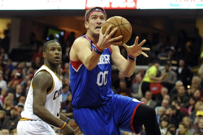 Nov 9, 2013; Cleveland, OH, USA; Philadelphia 76ers center Spencer Hawes (00) drives past Cleveland Cavaliers shooting guard Dion Waiters (3) in the second quarter at Quicken Loans Arena. Mandatory Credit: David Richard-USA TODAY Sports