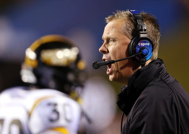 Nov 9, 2013; Ruston, LA, USA; Southern Miss Golden Eagles head coach Todd Monken yells to his players during their game against the Louisiana Tech Bulldogs in the first quarter at Joe Aillet Stadium. Mandatory Credit: Chuck Cook-USA TODAY Sports