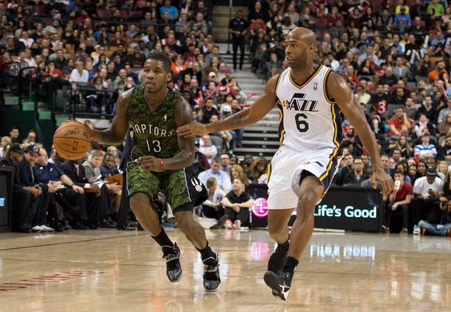 Nov 9, 2013; Toronto, Ontario, CAN; Toronto Raptors point guard Dwight Buycks (13) dribbles the ball as Utah Jazz point guard Jamaal Tinsley (6) tries to defend during the third period in a game at Air Canada Centre. The Toronto Raptors won 115-91. Mandatory Credit: Nick Turchiaro-USA TODAY Sports