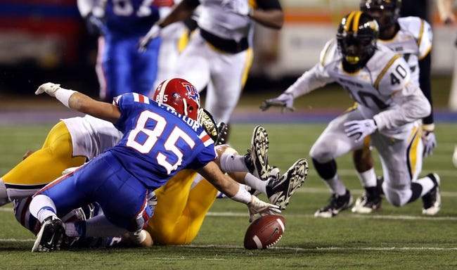 Nov 9, 2013; Ruston, LA, USA; Louisiana Tech Bulldogs wide receiver Trent Taylor (85)  reaches for a ball fumbled by teammate Hunter Lee during their game against the Southern Miss Golden Eagles in the second quarter at Joe Aillet Stadium. Southern Miss Golden Eagles linebacker C.J. Perry (40)recovered the fumble. Mandatory Credit: Chuck Cook-USA TODAY Sports