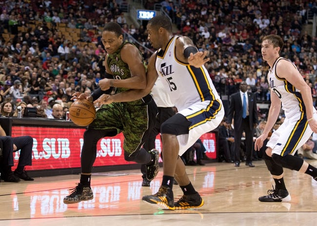Nov 9, 2013; Toronto, Ontario, CAN; Toronto Raptors shooting guard DeMar DeRozan (10) drives to the basket as Utah Jazz power forward Derrick Favors (15) tries to defend during the third period in a game at Air Canada Centre. The Toronto Raptors won 115-91. Mandatory Credit: Nick Turchiaro-USA TODAY Sports