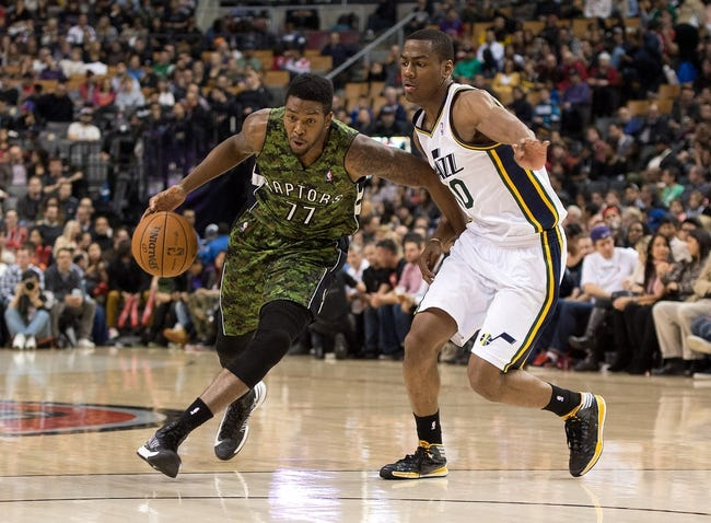 Nov 9, 2013; Toronto, Ontario, CAN; Toronto Raptors shooting guard Julyan Stone (77) drive to the basket as Utah Jazz point guard Alec Burks (10) tries to defend  during the fourth period in a game at Air Canada Centre. The Toronto Raptors won 115-91. Mandatory Credit: Nick Turchiaro-USA TODAY Sports
