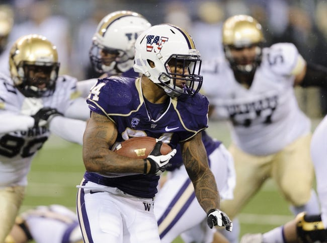 Nov 9, 2013; Seattle, WA, USA; Washington Huskies running back Jesse Callier (24) runs with the ball during the 1st half against the Colorado Buffaloes at Husky Stadium. Mandatory Credit: Steven Bisig-USA TODAY Sports