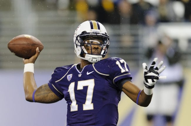 Nov 9, 2013; Seattle, WA, USA; Washington Huskies quarterback Keith Price (17) passes the ball against the Colorado Buffaloes during the 1st half at Husky Stadium. Mandatory Credit: Steven Bisig-USA TODAY Sports