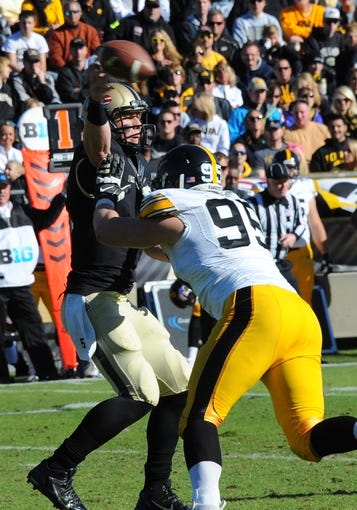 Nov 9, 2013; West Lafayette, IN, USA;  Purdue Boilermakers quarterback Danny Etling (5) looks to pass as he is tackled by Iowa Hawkeyes defensive lineman Nathan Bazata (99) in the 2nd half in the game against the Iowa Hawkeyes at Ross Ade Stadium. Mandatory Credit: Sandra Dukes-USA TODAY Sports