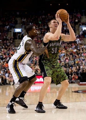 Nov 9, 2013; Toronto, Ontario, CAN; Toronto Raptors power forward Tyler Hansbrough (50) attempts a shot as Utah Jazz power forward Marvin Williams (2) tries to defend during the fourth period in a game at Air Canada Centre. The Toronto Raptors won 115-91. Mandatory Credit: Nick Turchiaro-USA TODAY Sports