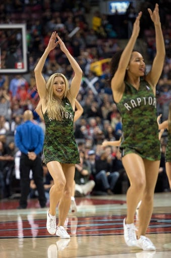 Nov 9, 2013; Toronto, Ontario, CAN; Toronto Raptors dancers perform during a break in the fourth period during a game against the Utah Jazz at Air Canada Centre. The Toronto Raptors won 115-91. Mandatory Credit: Nick Turchiaro-USA TODAY Sports
