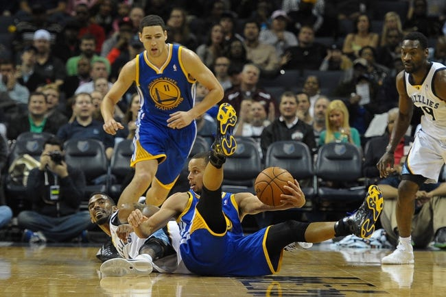 Nov 9, 2013; Memphis, TN, USA; Memphis Grizzlies point guard Mike Conley (11) and Golden State Warriors point guard Stephen Curry (30) fight for the ball during the third quarter at FedExForum. Mandatory Credit: Justin Ford-USA TODAY Sports