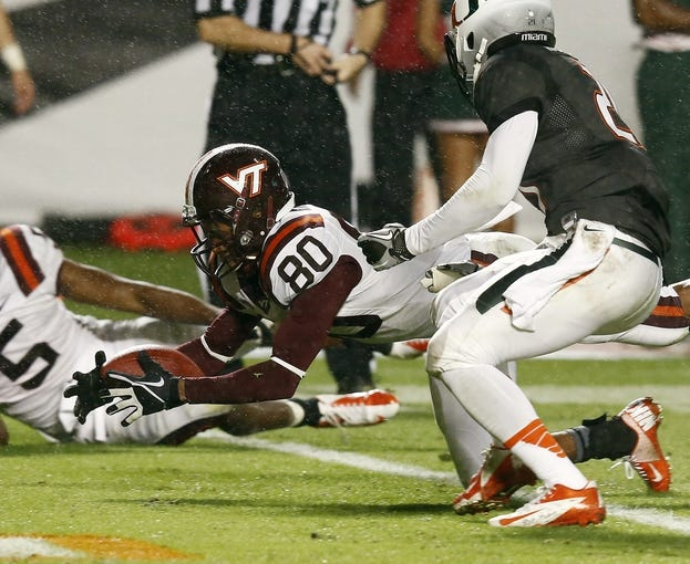Nov 9, 2013; Miami Gardens, FL, USA;  Virginia Tech Hokies wide receiver Demitri Knowles (80) recovers a fumble for a touchdown by teammate wide receiver Willie Byrn (not pictured) against the  Miami Hurricanes in the third quarter at Sun Life Stadium. Mandatory Credit: Robert Mayer-USA TODAY Sports