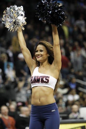 Nov 9, 2013; Atlanta, GA, USA; Atlanta Hawks cheerleader performs against the Orlando Magic in the fourth quarter at Philips Arena. The Hawks defated the Magic 104-94. Mandatory Credit: Brett Davis-USA TODAY Sports