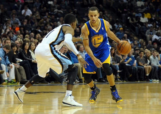 Nov 9, 2013; Memphis, TN, USA; Golden State Warriors point guard Stephen Curry (30) handles the ball against Memphis Grizzlies point guard Mike Conley (11) during the fourth quarter at FedExForum. The Grizzlies won 108-90.  Mandatory Credit: Justin Ford-USA TODAY Sports