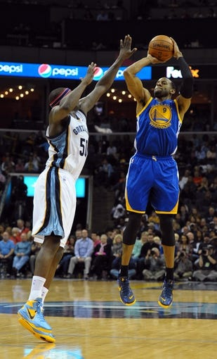 Nov 9, 2013; Memphis, TN, USA; Golden State Warriors small forward Andre Iguodala (9) shoots the ball over Memphis Grizzlies power forward Zach Randolph (50) during the fourth quarter at FedExForum. The Grizzlies won 108-90.  Mandatory Credit: Justin Ford-USA TODAY Sports
