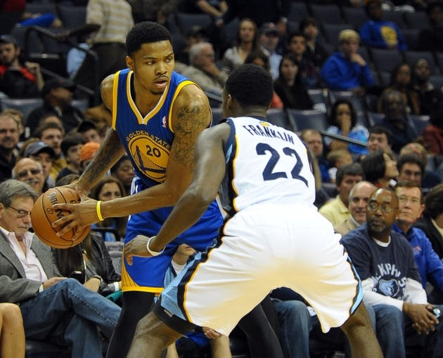 Nov 9, 2013; Memphis, TN, USA; Golden State Warriors shooting guard Kent Bazemore (20) and Memphis Grizzlies shooting guard Jamaal Franklin (22) during the fourth quarter at FedExForum. The Grizzlies won 108-90.  Mandatory Credit: Justin Ford-USA TODAY Sports