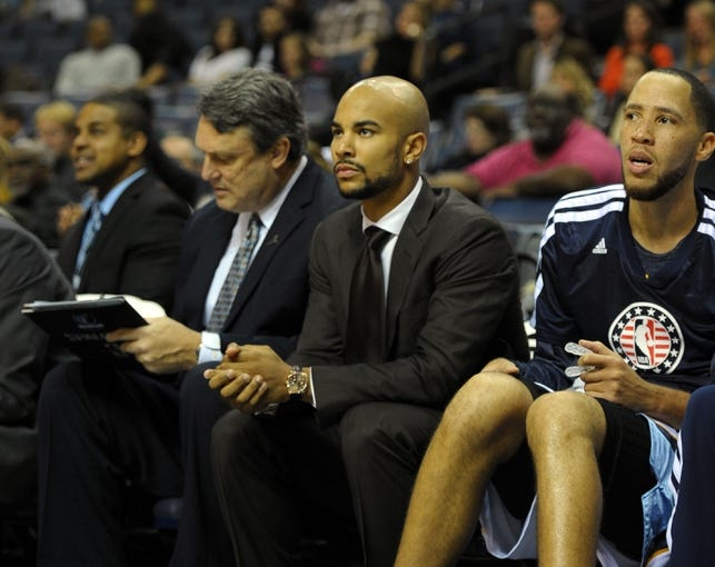 Nov 9, 2013; Memphis, TN, USA; Memphis Grizzlies point guard Jerryd Bayless (middle) sits on the bench in the game against the Golden State Warriors during the fourth quarter at FedExForum. The Grizzlies won 108-90.  Mandatory Credit: Justin Ford-USA TODAY Sports