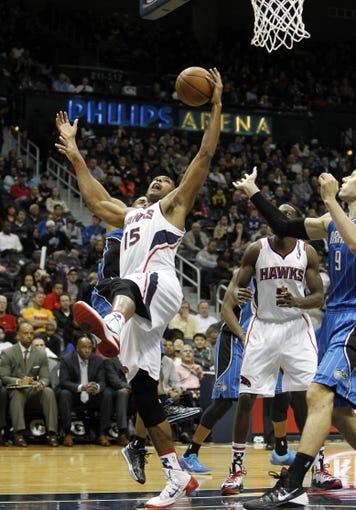 Nov 9, 2013; Atlanta, GA, USA; Atlanta Hawks center Al Horford (15) grabs the rebound against the Orlando Magic in the third quarter at Philips Arena. Mandatory Credit: Brett Davis-USA TODAY Sports