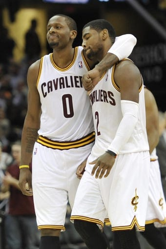 Nov 9, 2013; Cleveland, OH, USA; Cleveland Cavaliers shooting guard C.J. Miles (0) and point guard Kyrie Irving (2) react after Irving's basket late in the second overtime against the Philadelphia 76ers at Quicken Loans Arena. Mandatory Credit: David Richard-USA TODAY Sports