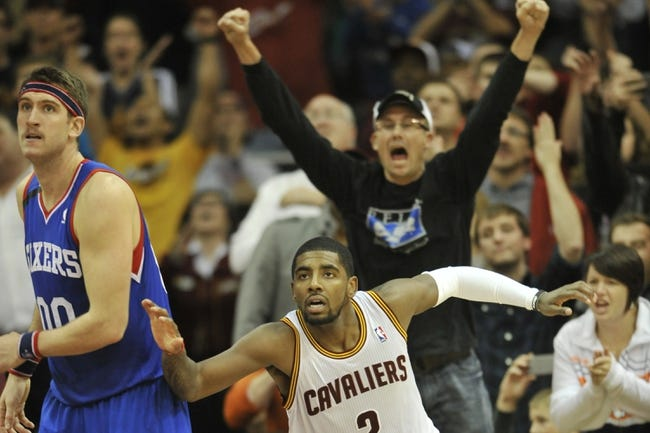 Nov 9, 2013; Cleveland, OH, USA; Philadelphia 76ers center Spencer Hawes (00) and Cleveland Cavaliers point guard Kyrie Irving (2) react after Irving's basket late in the second overtime at Quicken Loans Arena. Mandatory Credit: David Richard-USA TODAY Sports