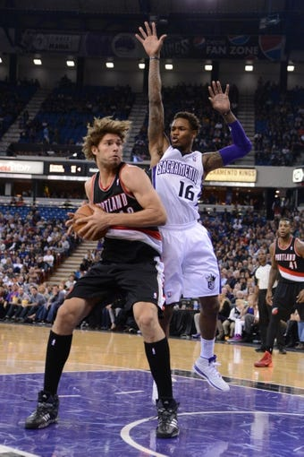 November 9, 2013; Sacramento, CA, USA; Portland Trail Blazers center Robin Lopez (42, left) is defended by Sacramento Kings shooting guard Ben McLemore (16) during the second quarter at Sleep Train Arena. Mandatory Credit: Kyle Terada-USA TODAY Sports