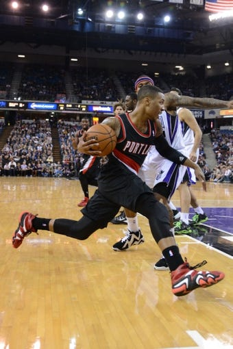 November 9, 2013; Sacramento, CA, USA; Portland Trail Blazers point guard Damian Lillard (0) dribbles the basketball against the Sacramento Kings during the second quarter at Sleep Train Arena. Mandatory Credit: Kyle Terada-USA TODAY Sports