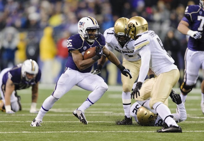 Nov 9, 2013; Seattle, WA, USA; Washington Huskies running back Bishop Sankey (25) carries the ball against the Colorado Buffaloes during the 2nd half at Husky Stadium. Washington defeated Colorado 59-7. Mandatory Credit: Steven Bisig-USA TODAY Sports