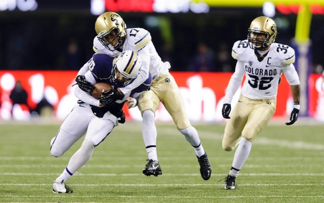 Nov 9, 2013; Seattle, WA, USA; Colorado Buffaloes defensive back Marques Mosley (17) tackles Washington Huskies quarterback Cyler Miles (10) during the 2nd half at Husky Stadium. Washington defeated Colorado 59-7. Mandatory Credit: Steven Bisig-USA TODAY Sports