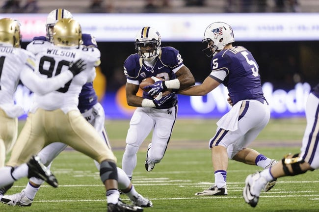 Nov 9, 2013; Seattle, WA, USA; Washington Huskies quarterback Jeff Lindquist (5) hands the ball off to Washington Huskies running back Deontae Cooper (32) during the 2nd half against the Colorado Buffaloes at Husky Stadium. Washington defeated Colorado 59-7. Mandatory Credit: Steven Bisig-USA TODAY Sports