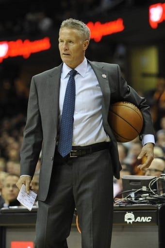 Nov 9, 2013; Cleveland, OH, USA; Philadelphia 76ers head coach Brett Brown holds the basketball in the third quarter against the Cleveland Cavaliers at Quicken Loans Arena. Mandatory Credit: David Richard-USA TODAY Sports